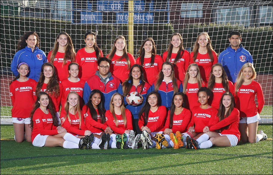 Girls Soccer team in front of goal